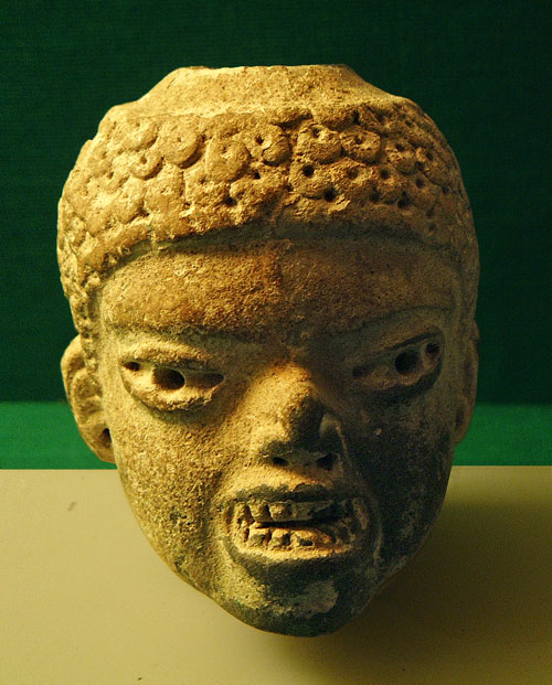 An Olmec Statue Head with fearsome appearance