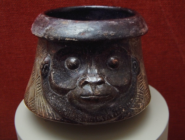 A Mayan bowl carved as a monkey head