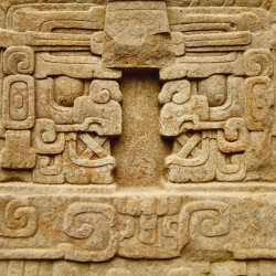 The boots of Cauac Sky on Stela E at Quirigua