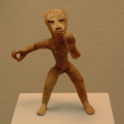Classic period figurine of a man rowing